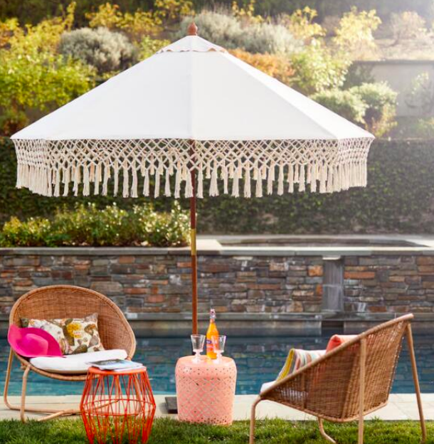 FRINGE 9FT OUTDOOR UMBRELLA BY WORLD MARKET  $54 ON SALE  Obsessed with this fringe umbrella and the boho vibe. We get so many compliments on it every time people come over. The natural hued canopy provides amazing shade and I can't believe it's on sale.