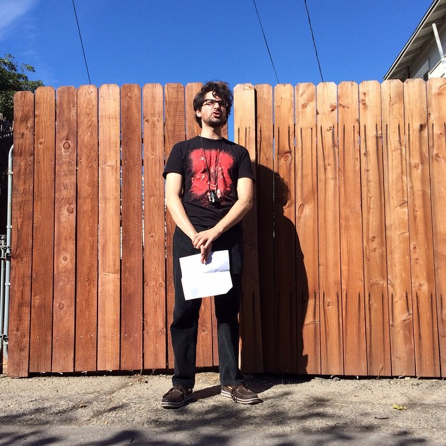 Charles Pieper as seen directing in front of a fence.