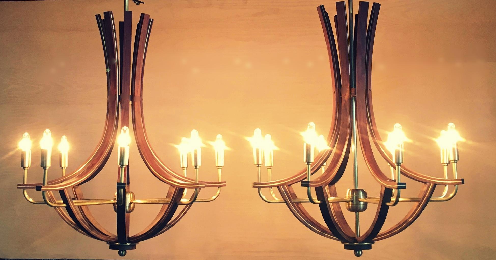 Walnut chandeliers inlayed with brass
