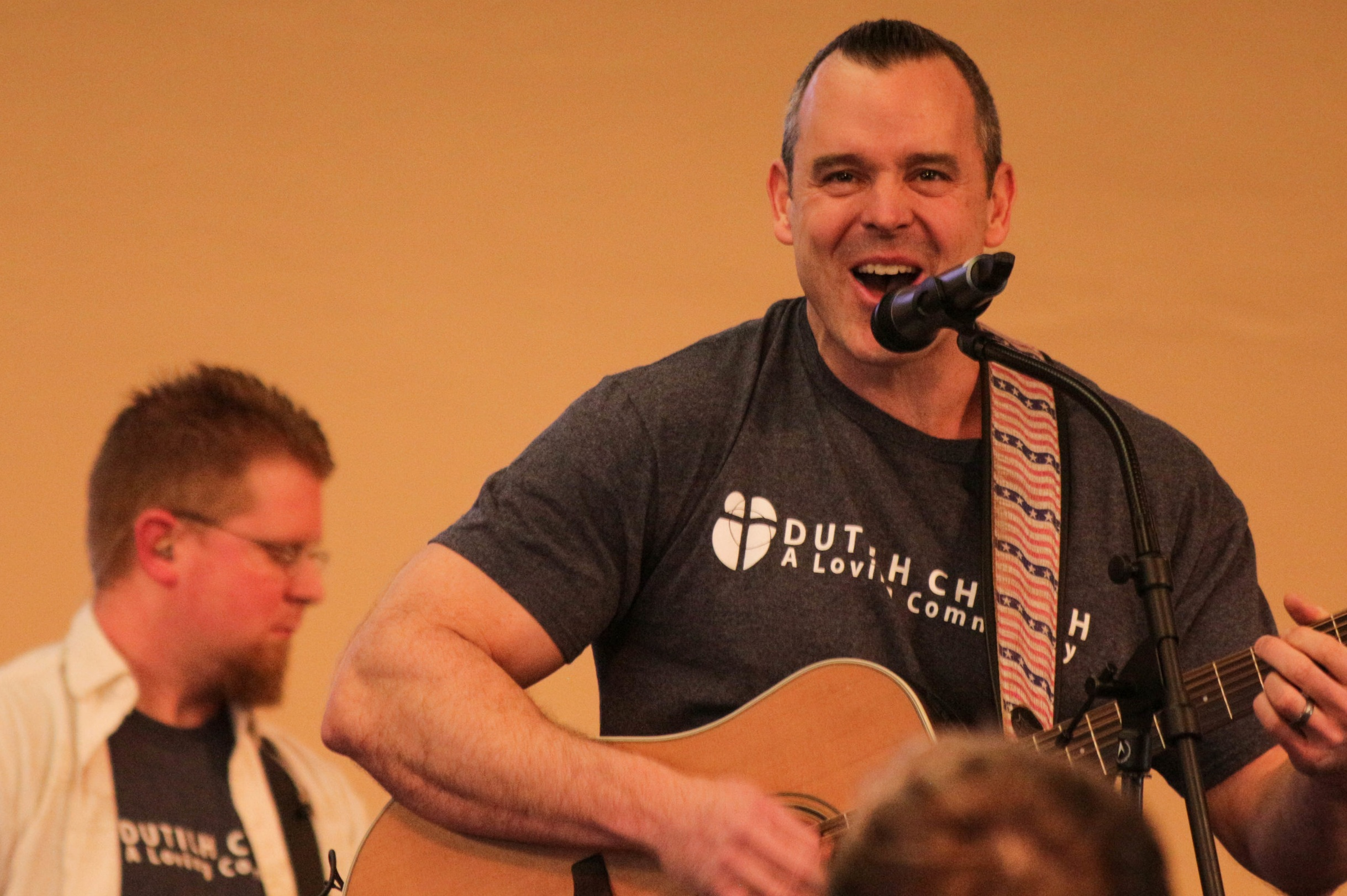 Dustin Bush leads the worship song at Dutilh's 9:30 a.m. service.   Photo courtesy of Sam Hogue.