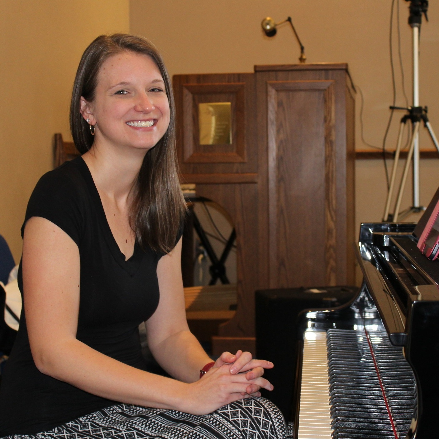 Maureen Konopka, Director of Music Ministries, plays piano.