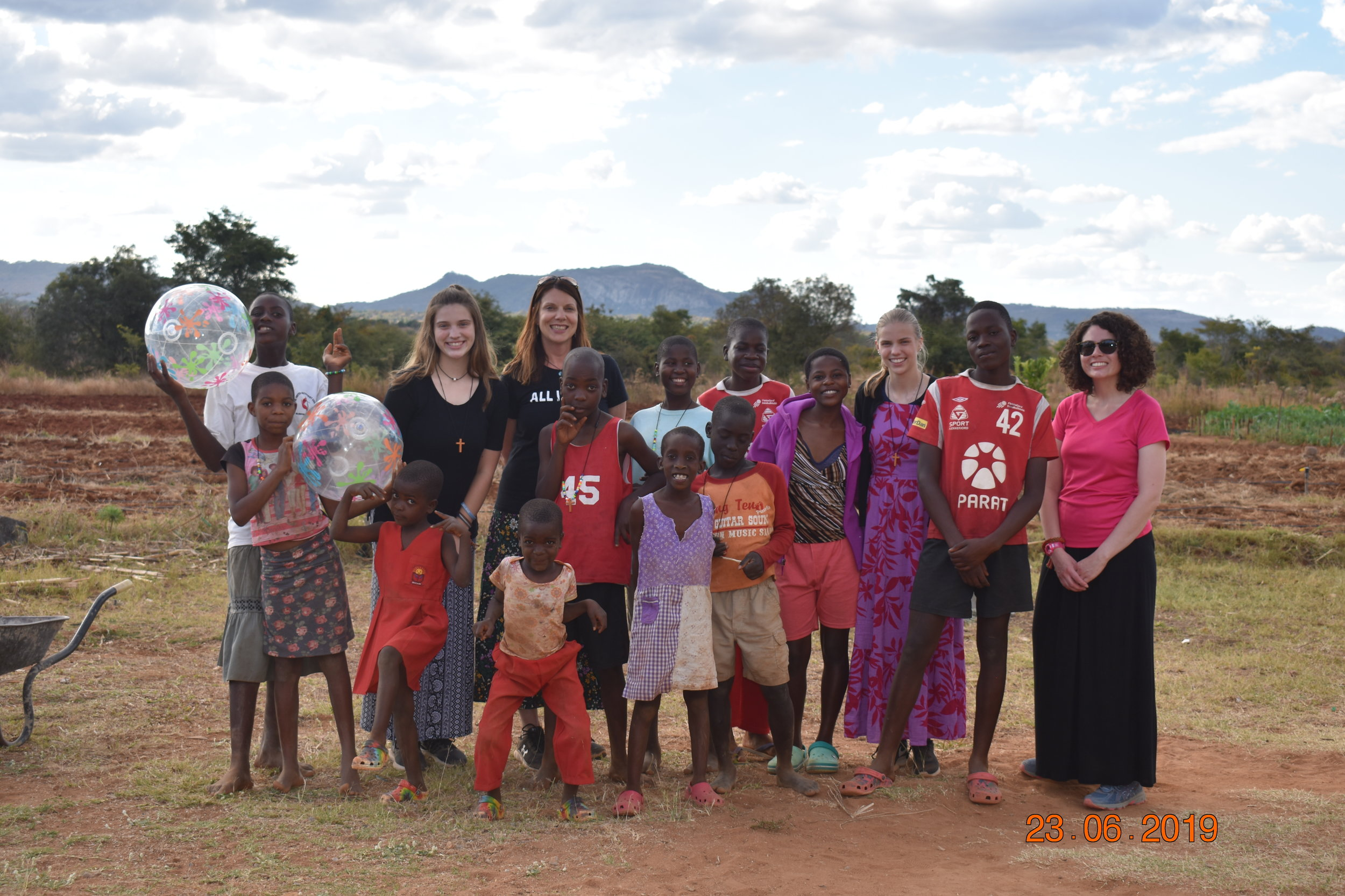 Members of the mission team alongside children in Nyadire. Photo courtesy of Tracy Ekstam.