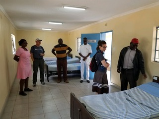 Members of Dutilh's mission team tour one of the medical clinics.