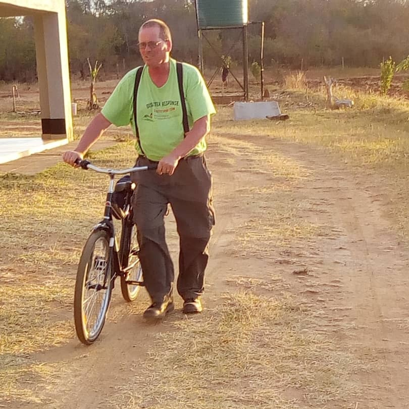A member of Dutilh's mission team delivers bicycles to children from the Home of Hope Orphanage.