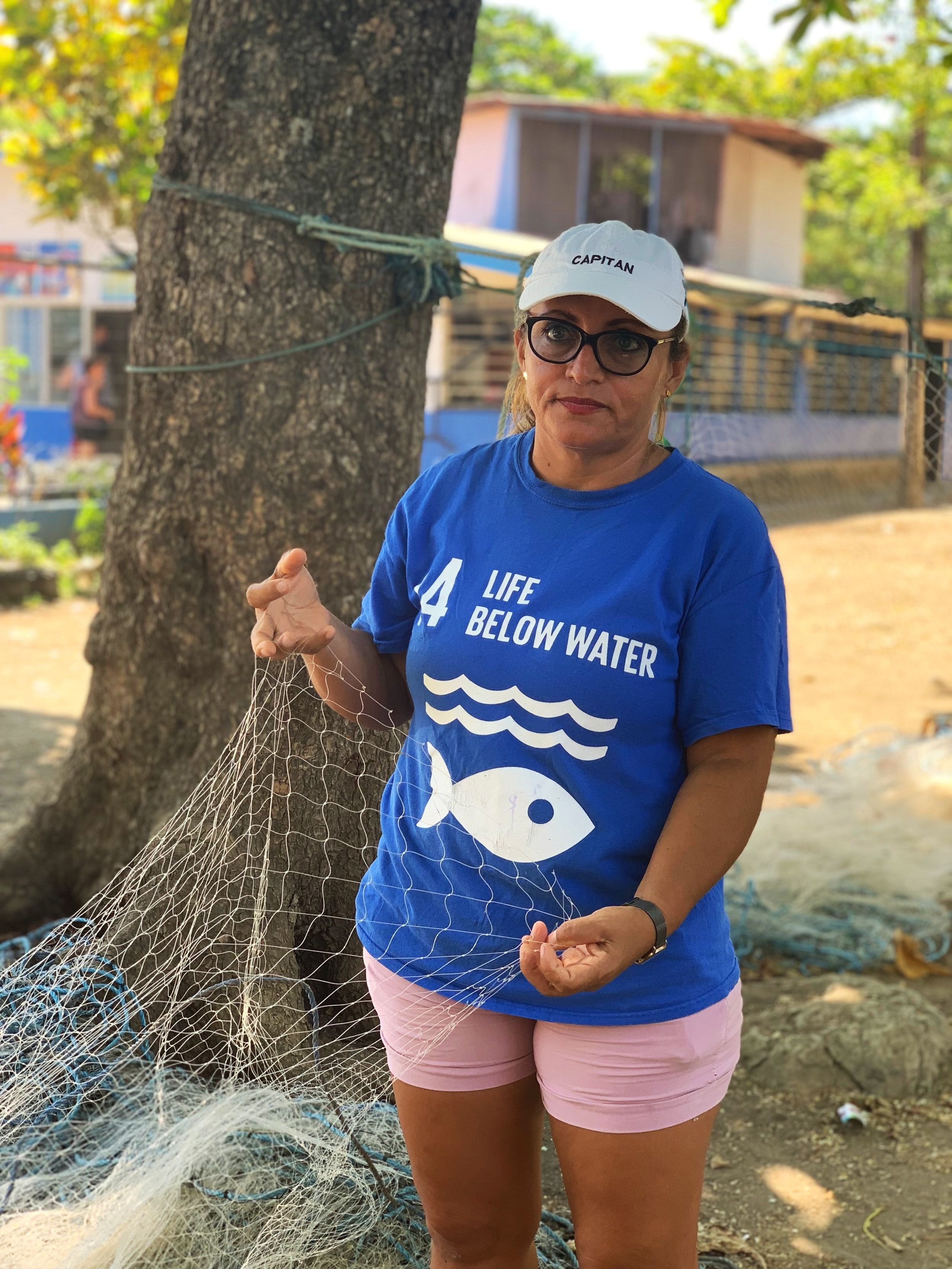 Jeannette Naranjo - Naranjo is the only female captain in the fishing cooperative. Here she shows a group of visitors appropriate fishing netting.Photo by: Rachael Durand