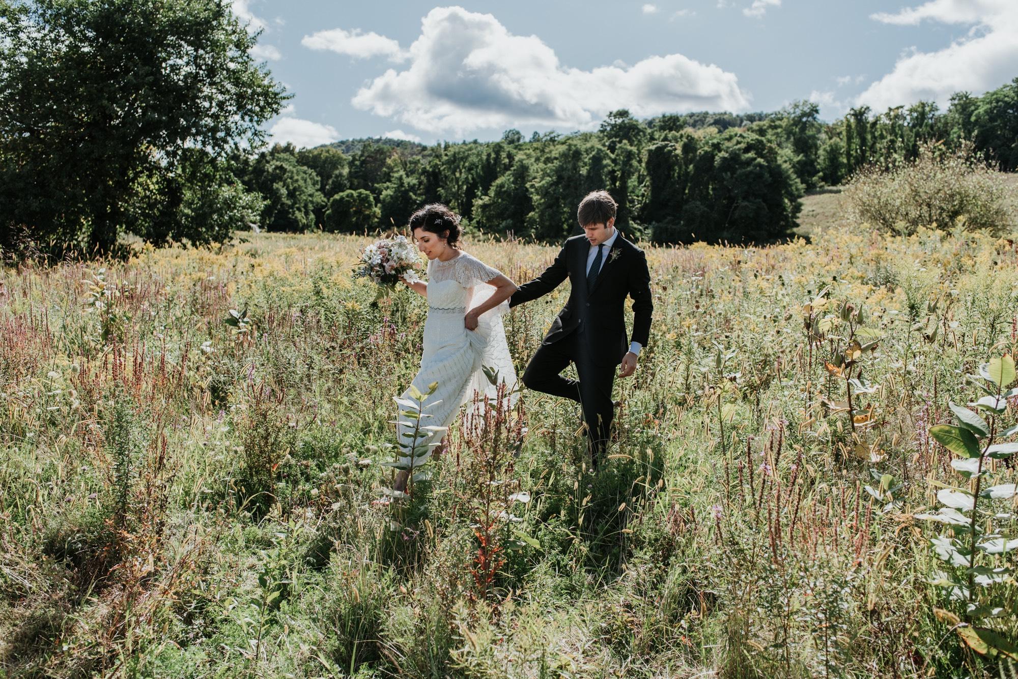 couple walking through fields