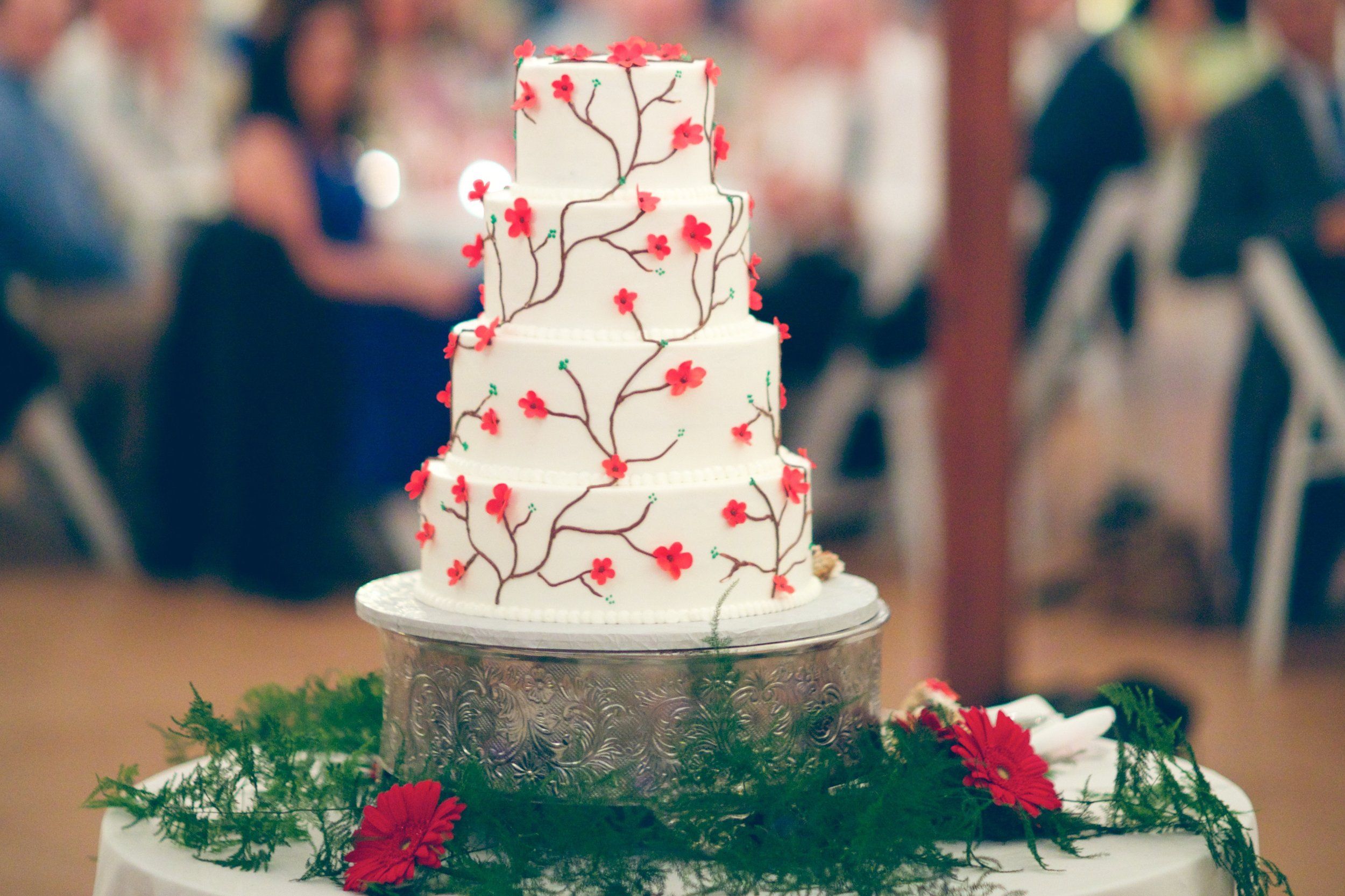 wedding cake with small red sugar flowers