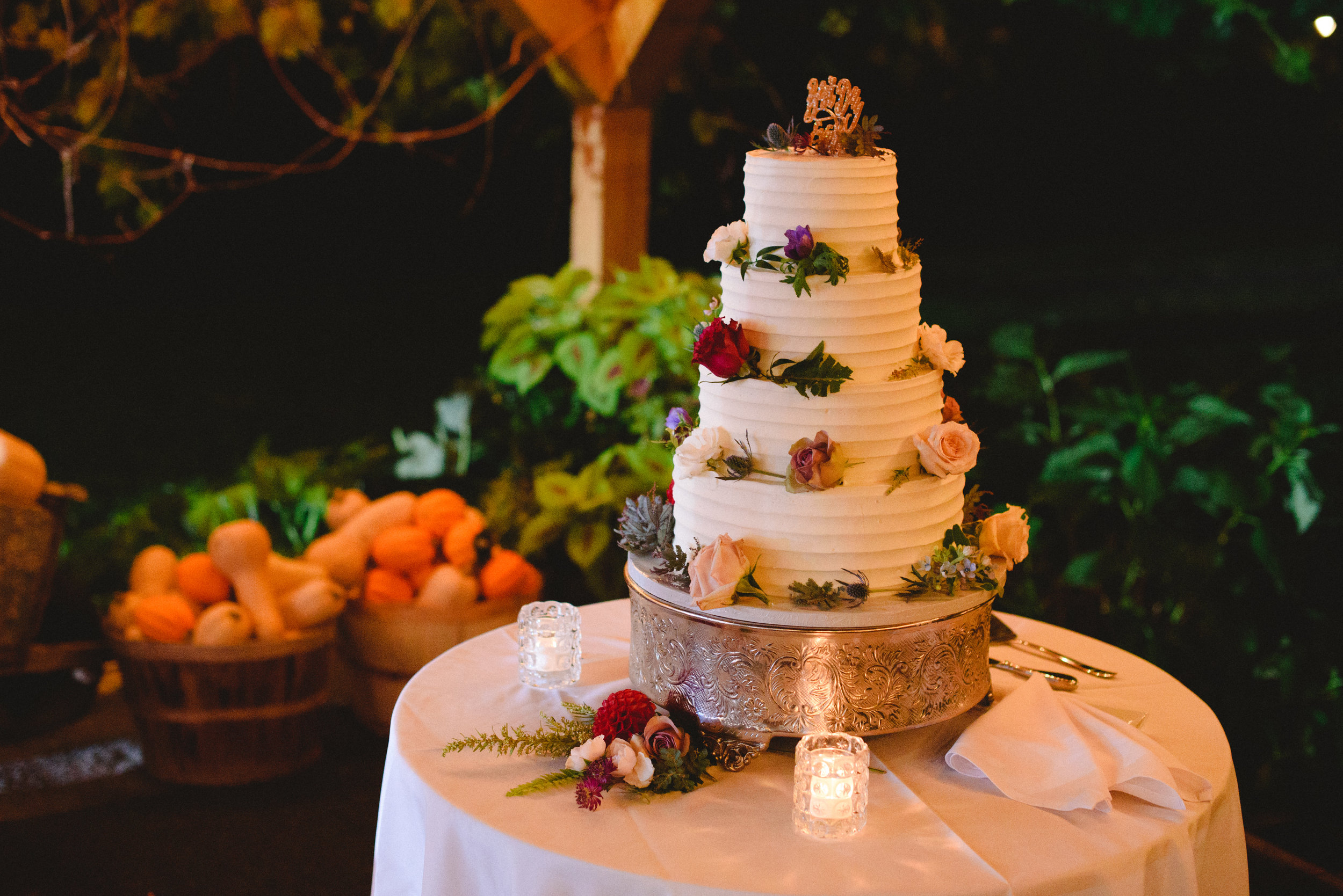 simple. vibrant. elegant white wedding cake with bright flowers