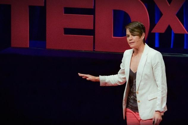 Elise delivering her TEDx talk.