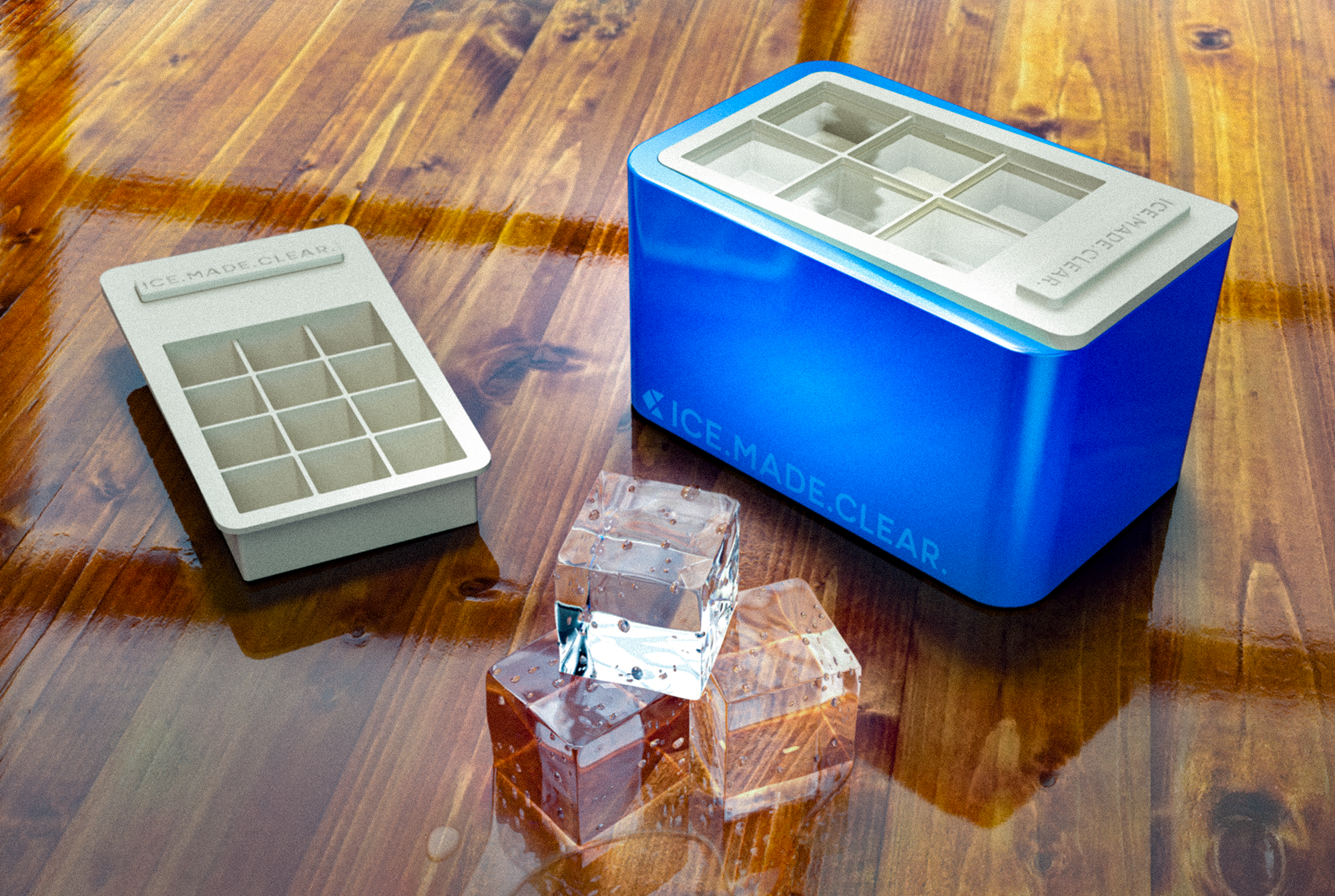 """The ICE.MADE.CLEAR.™ set comes complete with the freezing base and two interchangeable trays for making 2"""" enormous cubes and 1.25"""" jumbo cubes (for tall glasses)."""