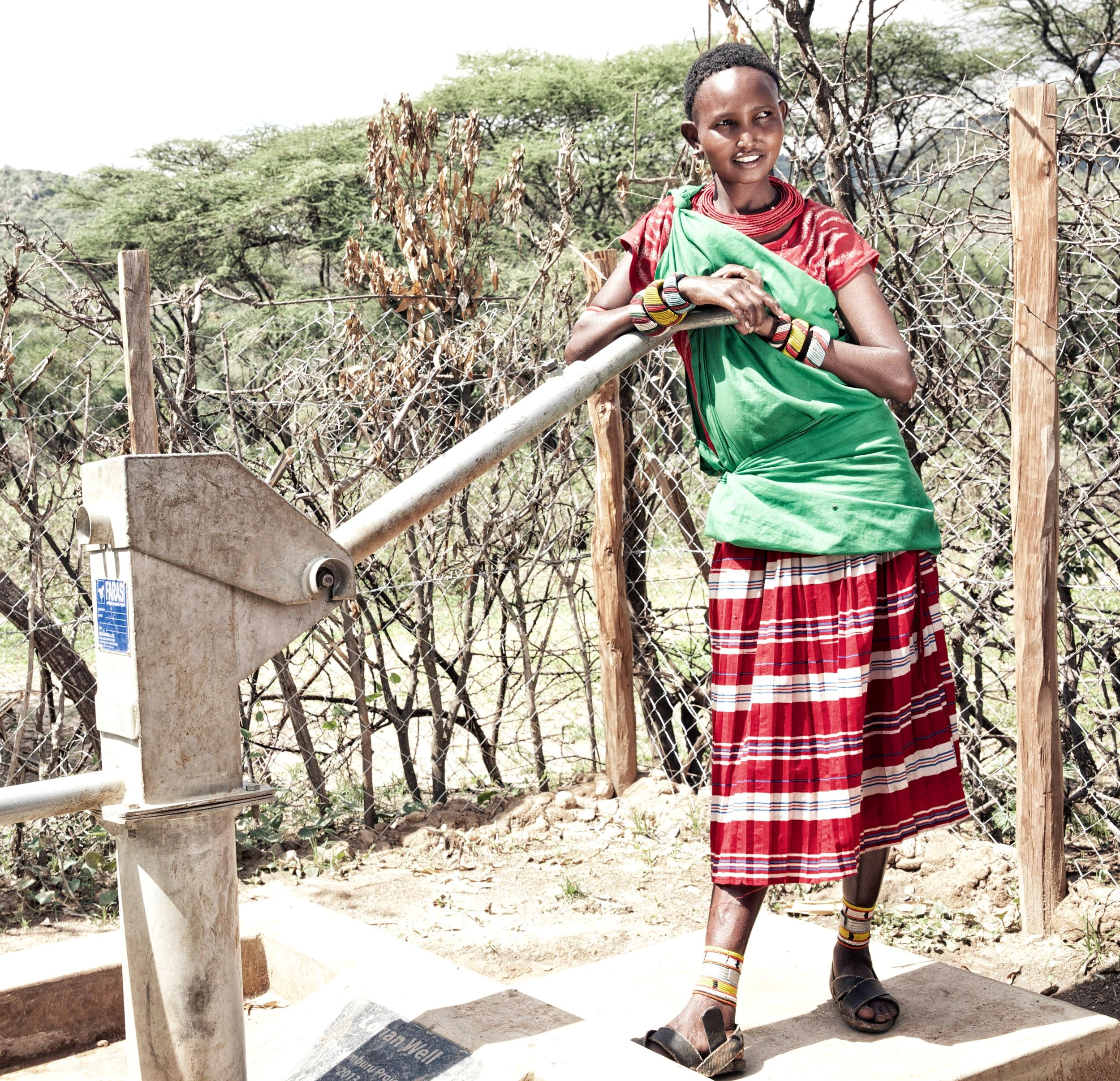 Young Girl pumping water, Samburu Kenya Africa