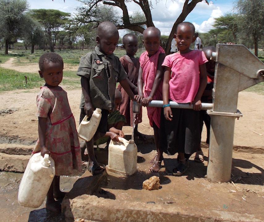 Children Pumping Water in Samburu Kenya Africa