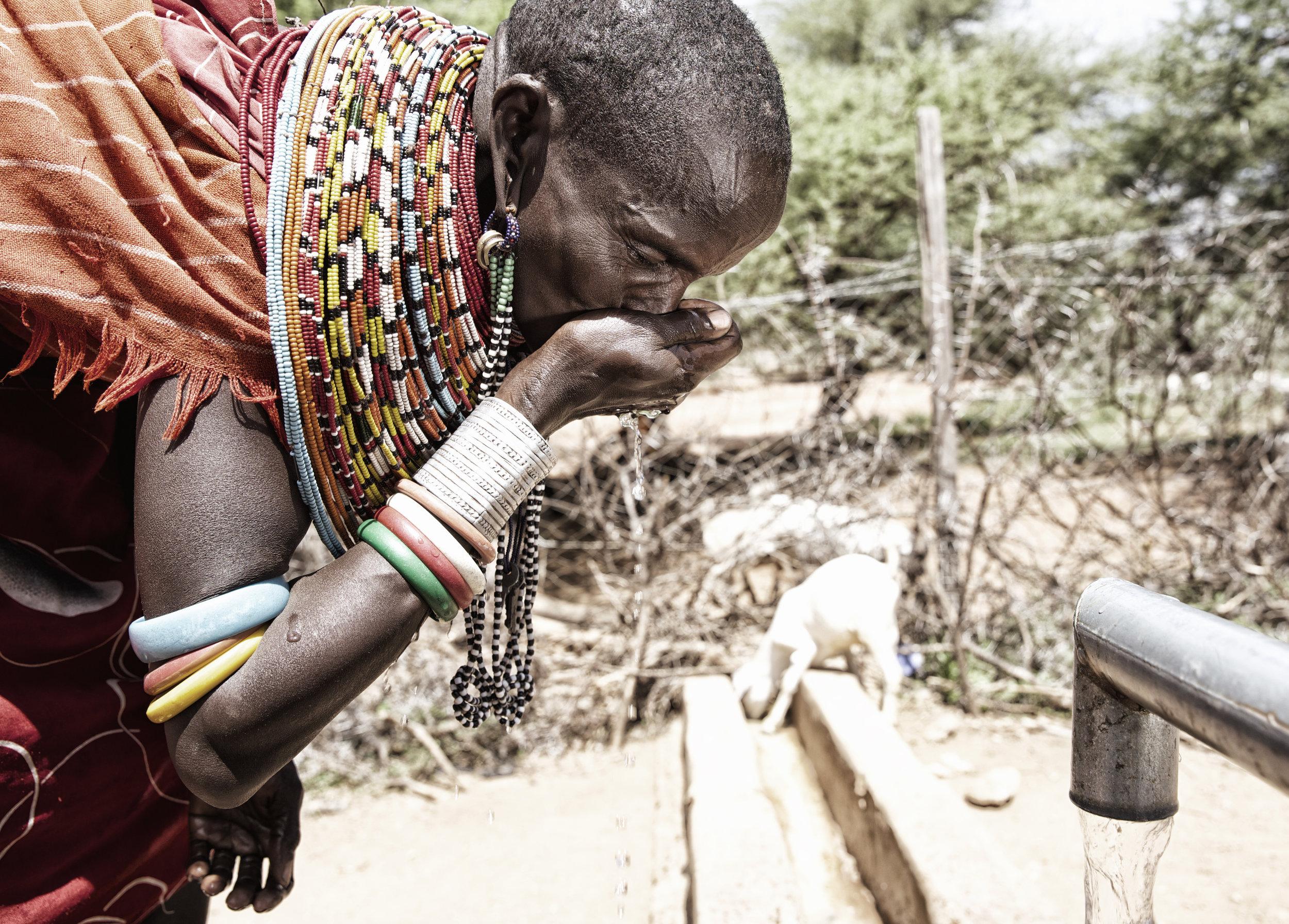 Woman Drinking Water from Well, Samburu Kenya Africa