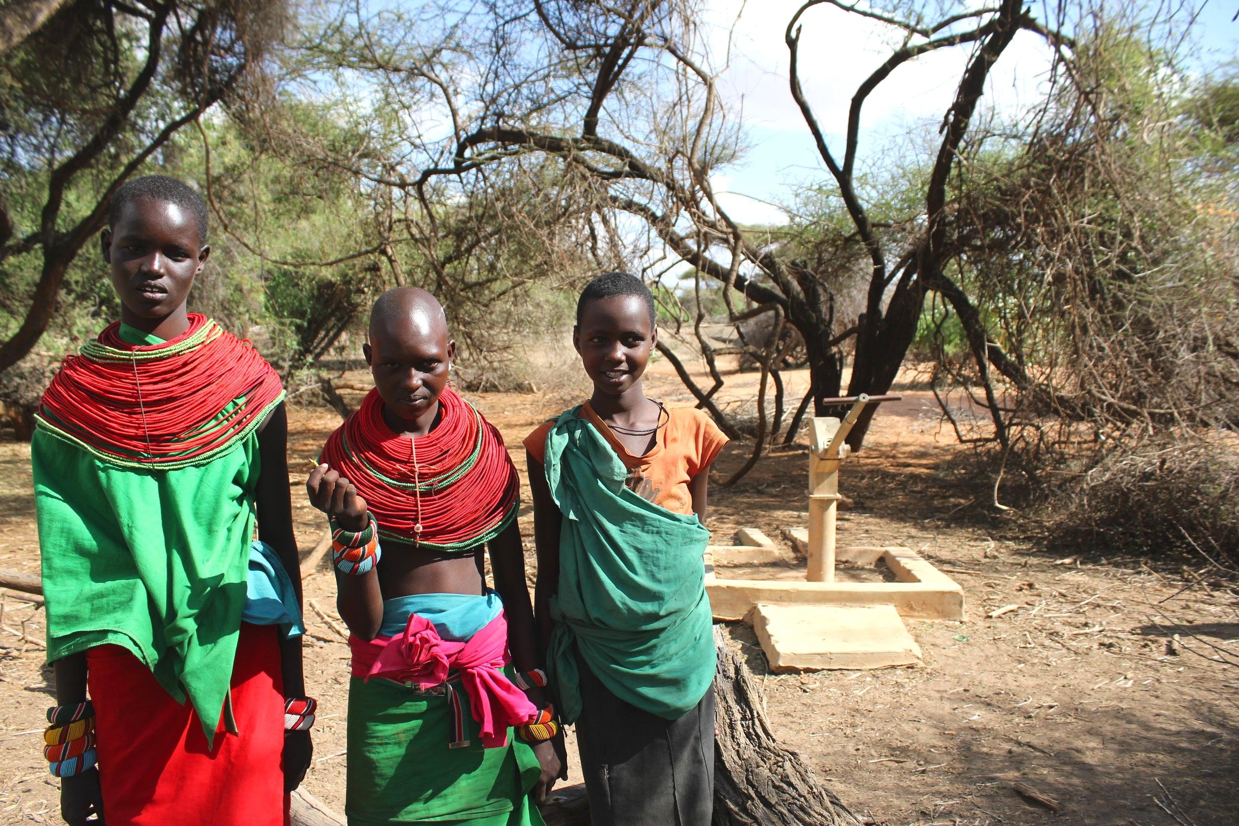 Young Girls Smiling by Well, Samburu Kenya Africa