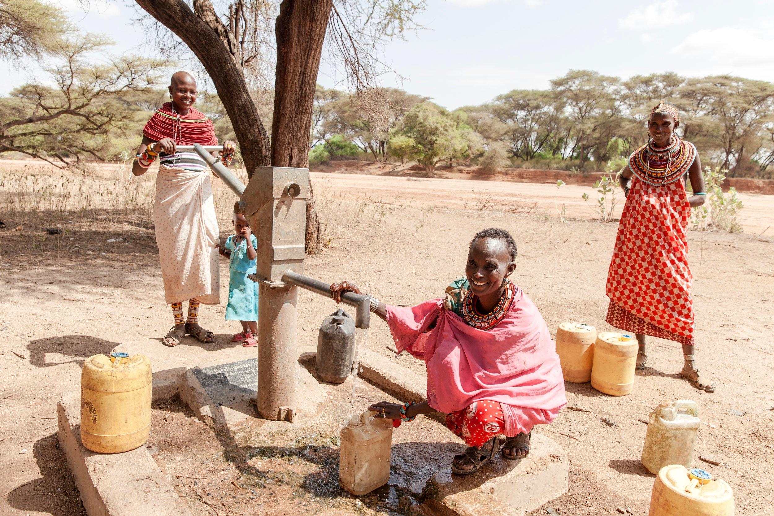 Smiling Women Fetching Water, Samburu Kenya Africa