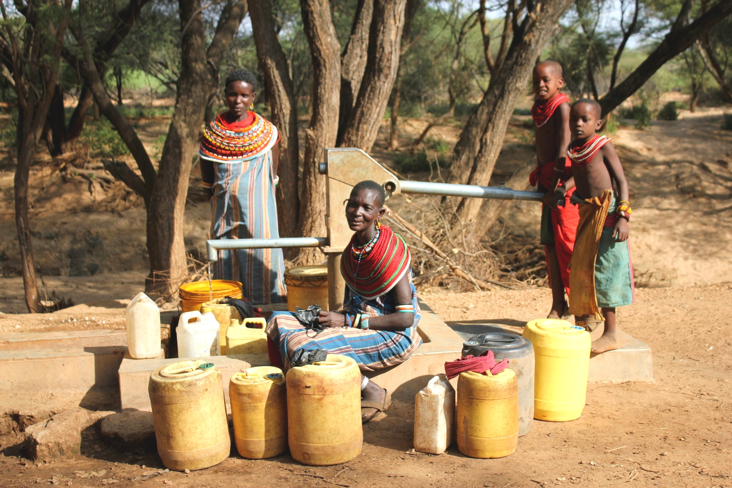 Women and Children with Jerry Cans by Water Well, Samburu Kenya Africa