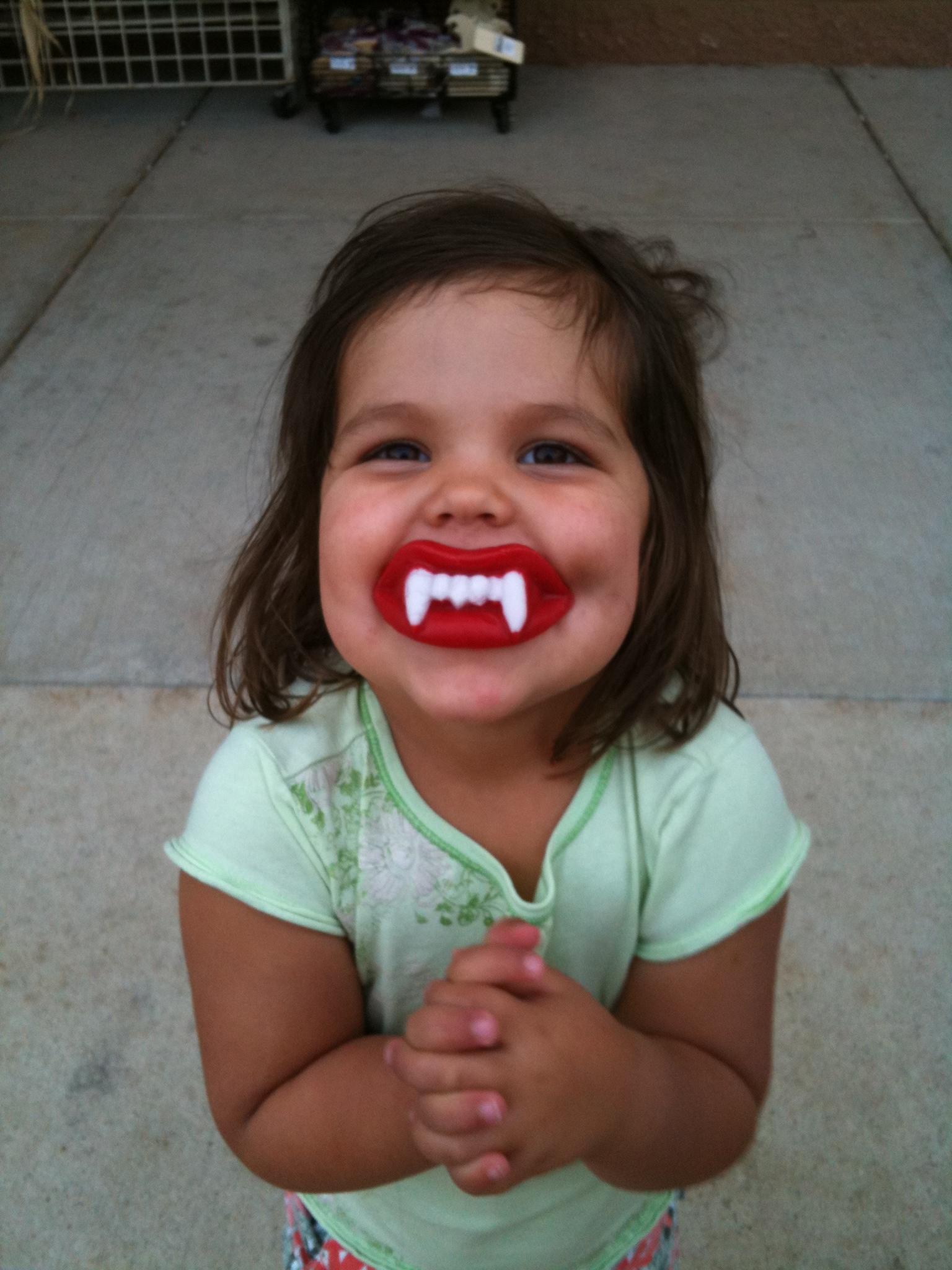 Gracie w wax teeth.JPG