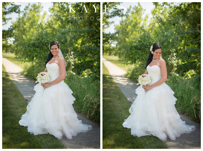 Captain's Club Wedding Photographer, Captains Club Grand Blanc Michigan Wedding photography, grand blanc michigan wedding portraits, mid michigan wedding photography,bride on sidewalk,bride alone, bride by herself, bride smiling, bridal portraits