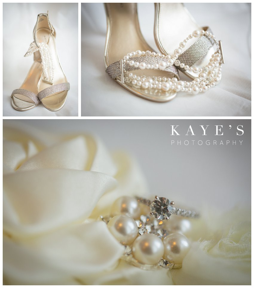 beautiful champagne gold shoes posed with a bracelet for wedding day portraits, gorgeous engagement ring on a bed of pearls
