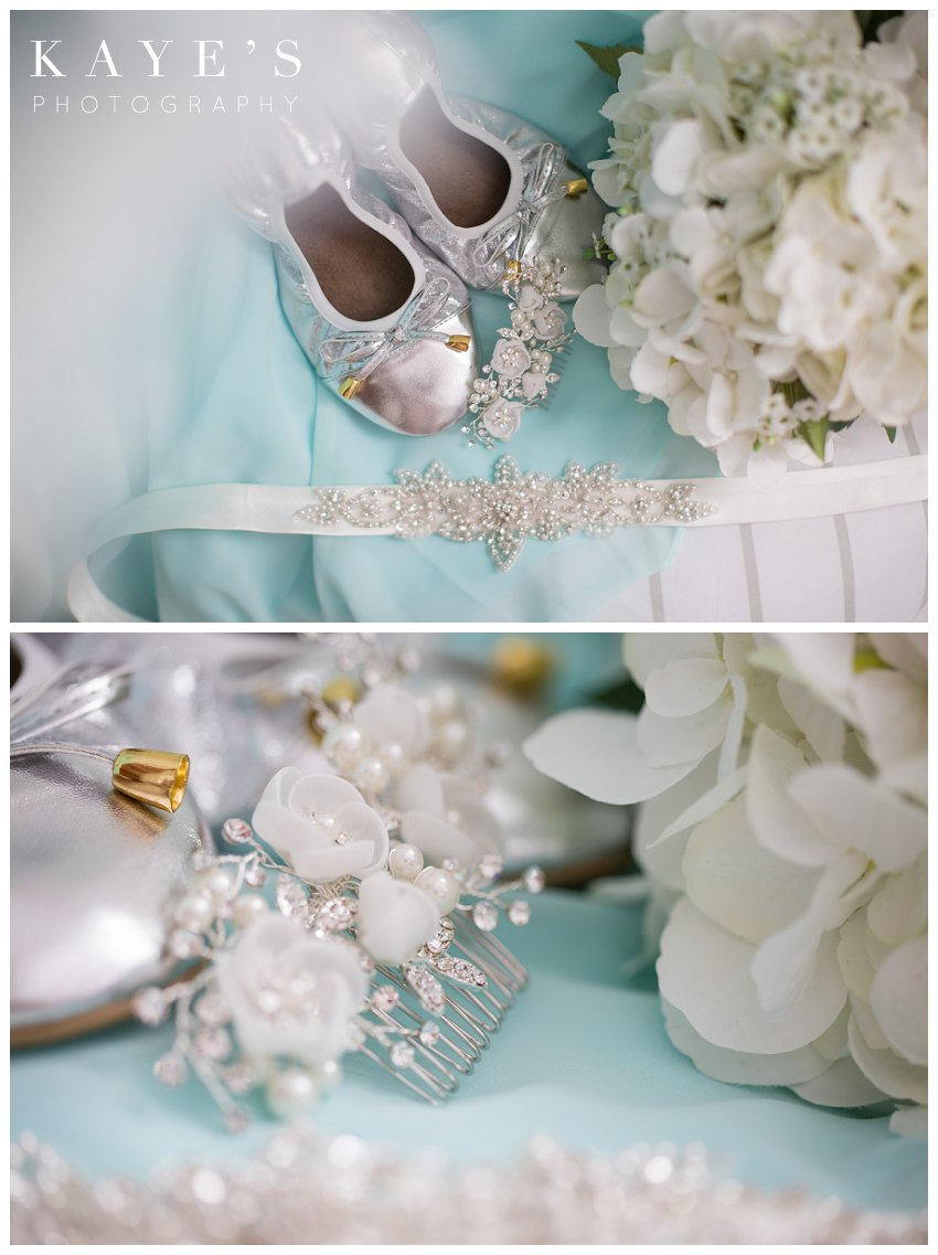 a styled portrait of a brides details from her wedding day including shoes, hair clip, and rhinestone belt