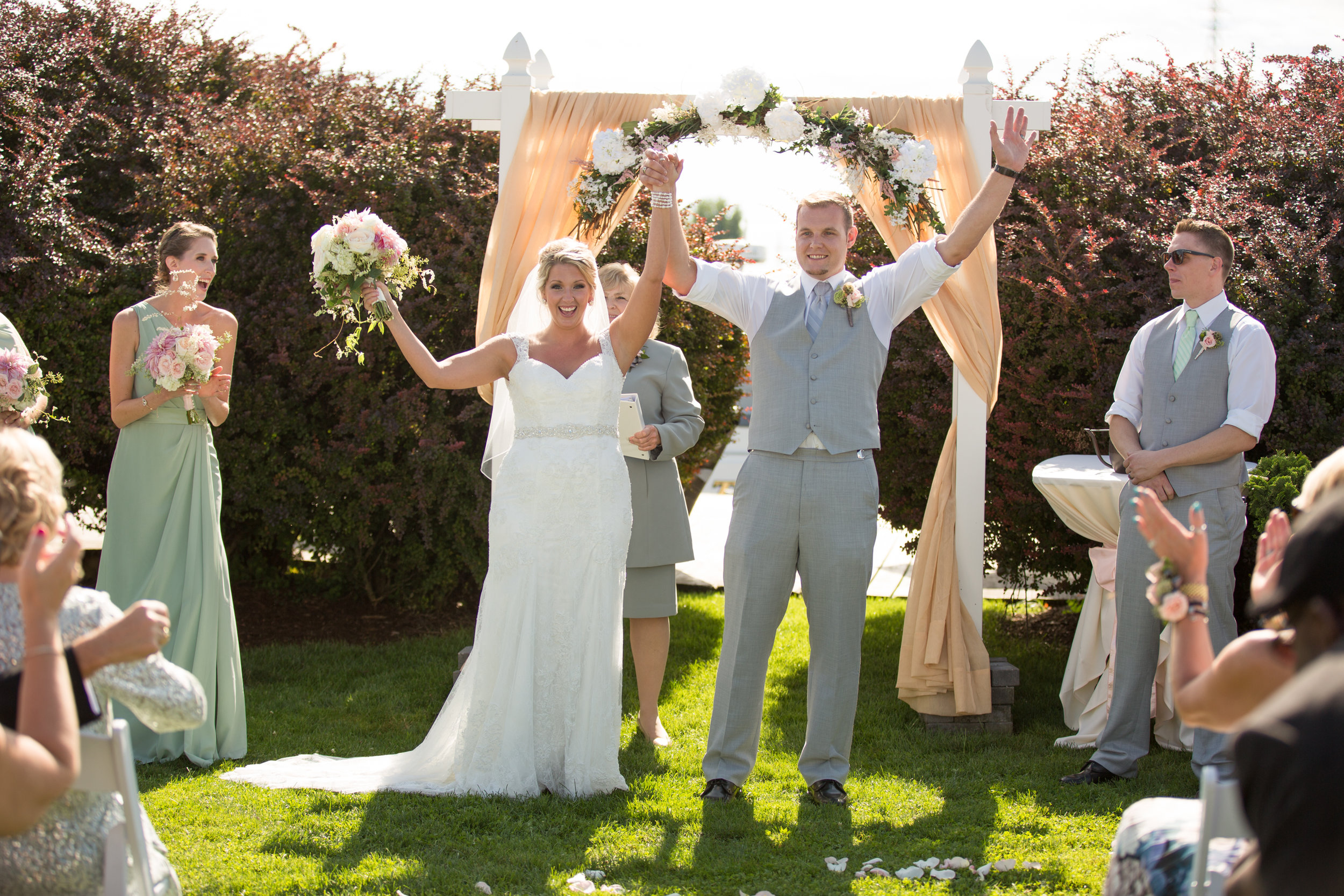 bride-and-groom-at-ceremony-celebrating-michigan-wedding-photographer