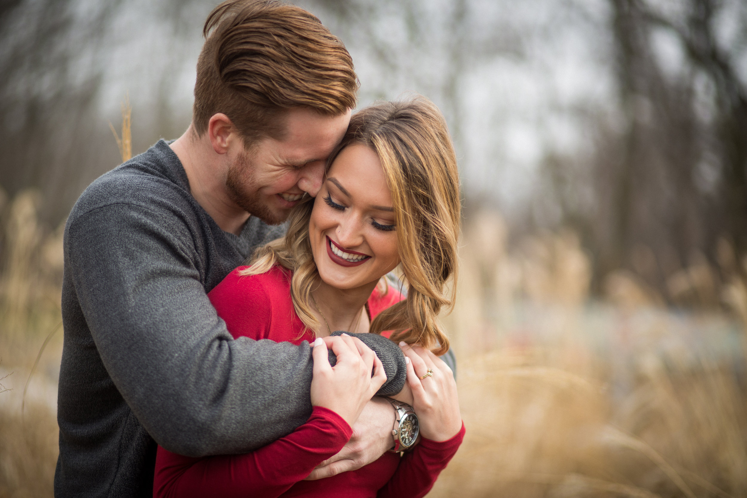 engaged couple in red dress in a field auburn hills wedding photographer