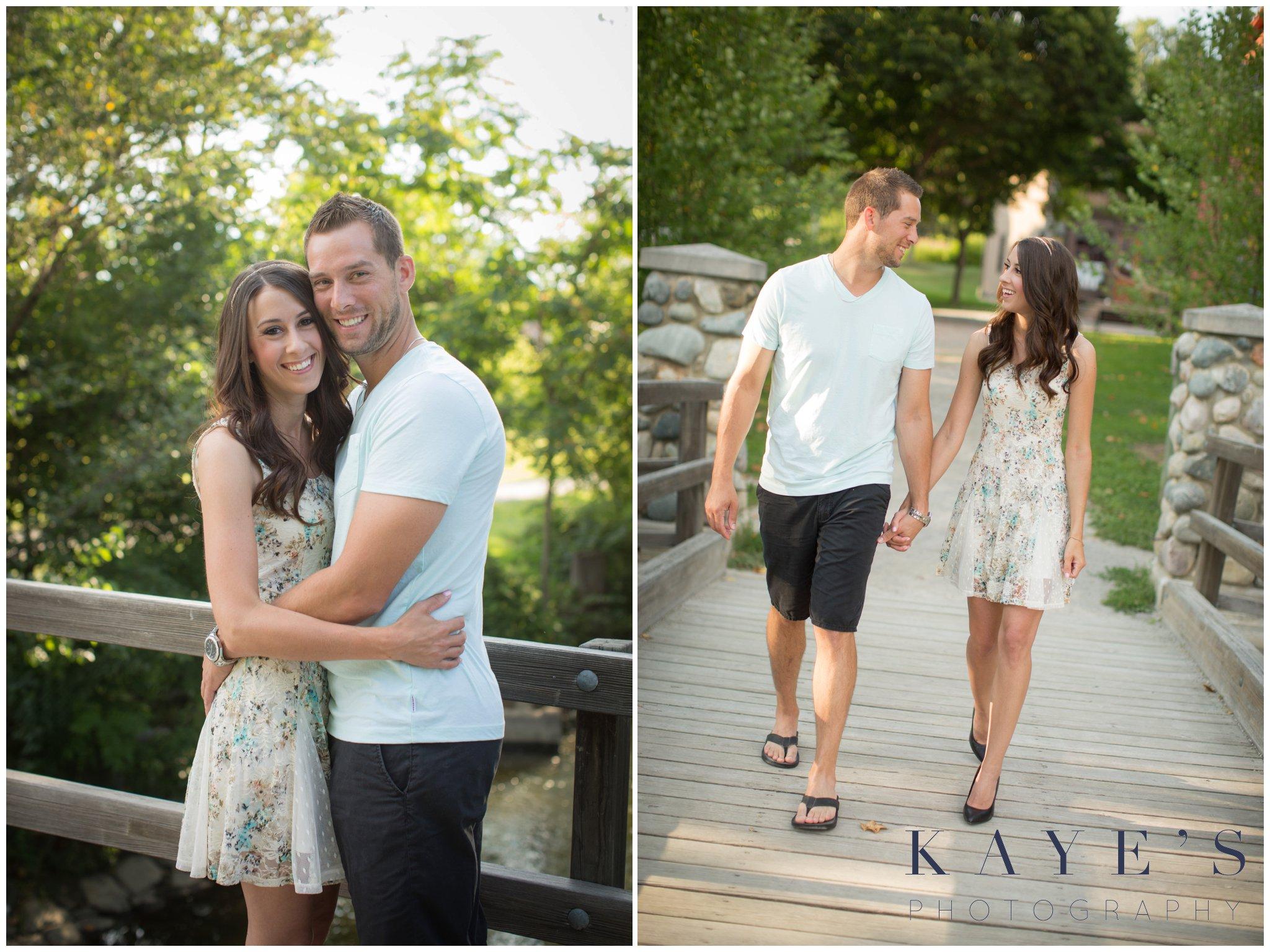 couple walking on a bridge during engagement photos