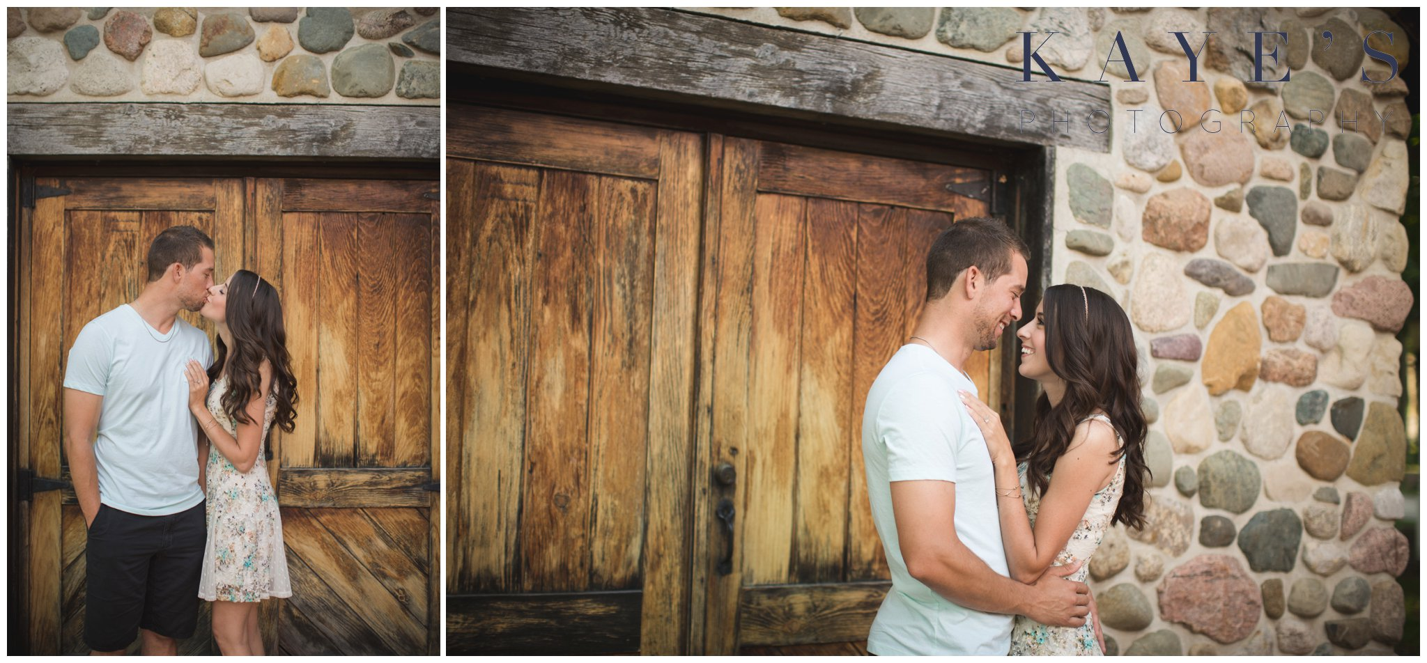 Couple getting professional portraits in front of a barn kissing