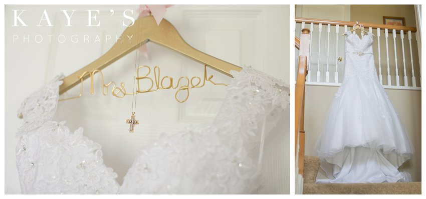 Wedding gown on personalized hanger with neckless hanging from banister in Flint Michigan