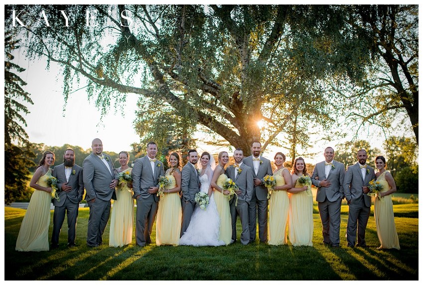 whole bridal party in couples with bride and groom during wedding day portraits at the lazy j ranch