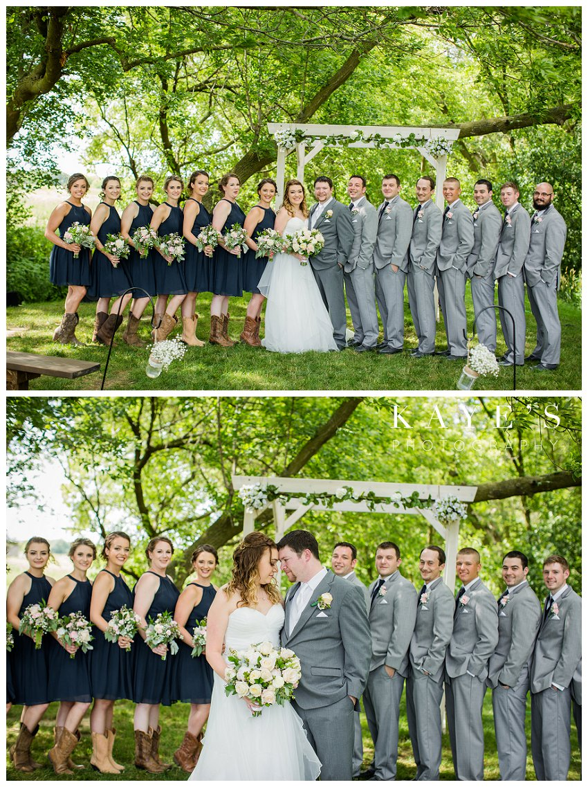 bridal party in navy dresses and grey tuxes at misty farms in ann arbor michigan