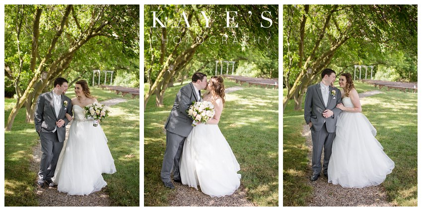 bride and groom posing for wedding portraits at misty farms in ann arbor michigan