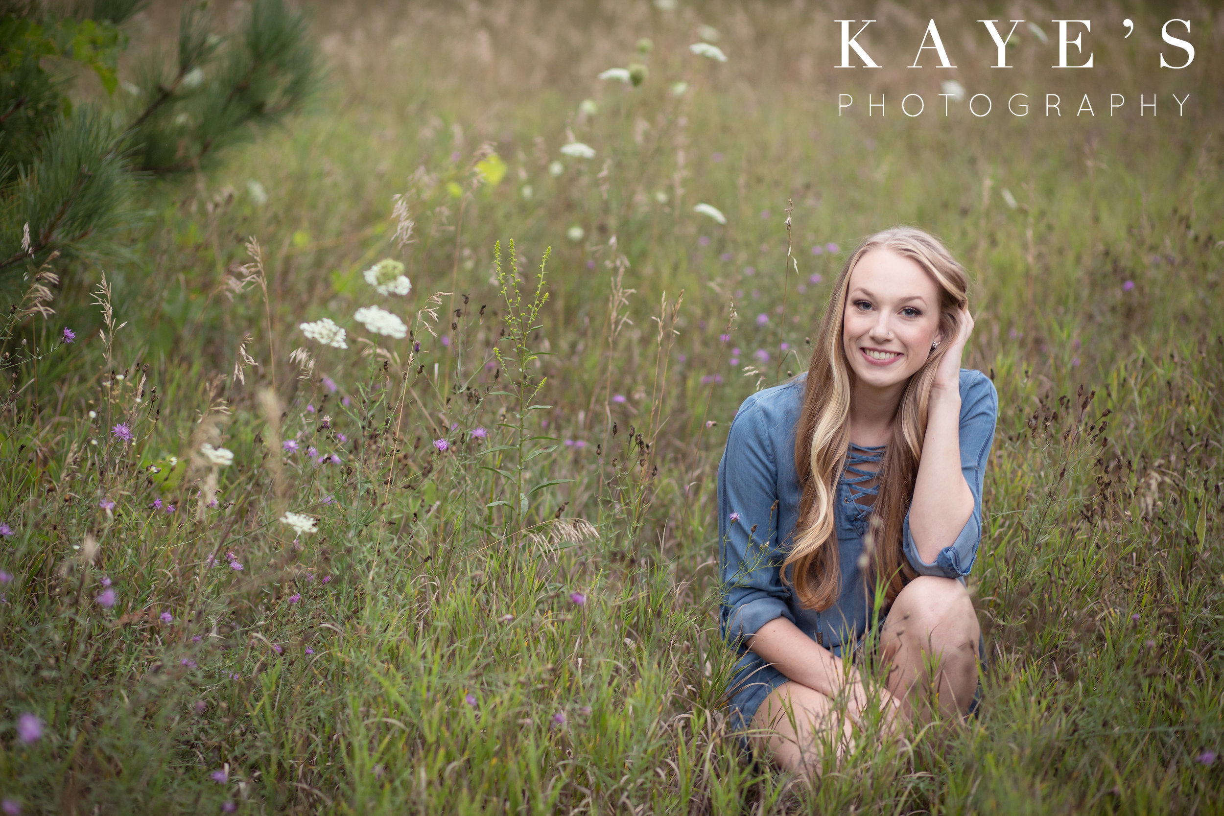 senior girl in field with flowers in holly michigan