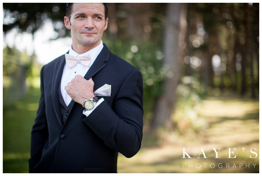 stunning portraits of groom getting ready with kayes photography
