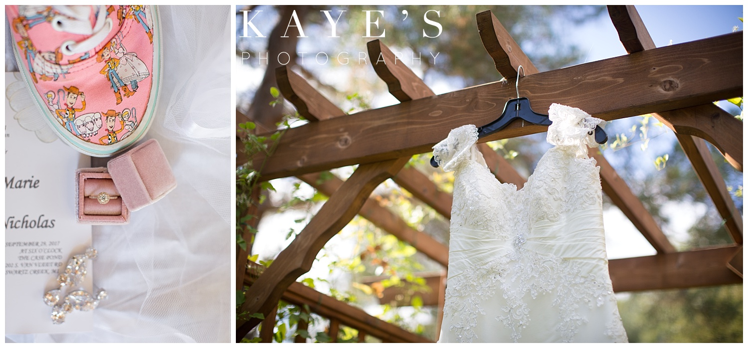 wedding dress hanging with ring in velvet ring box and disney shoes by kayes photography