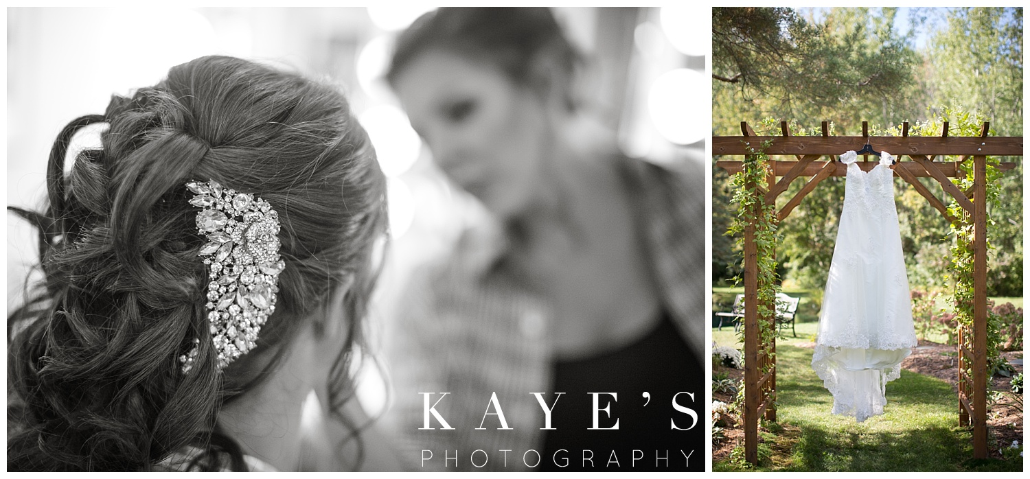 wedding dress hanging with hair and makeup on wedding day with kayes photography