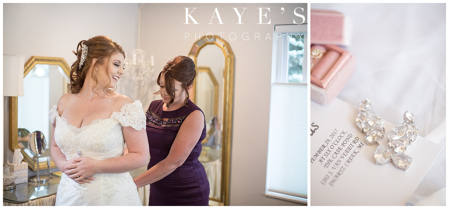 bride getting ready with mother with earrings and wedding jewerly