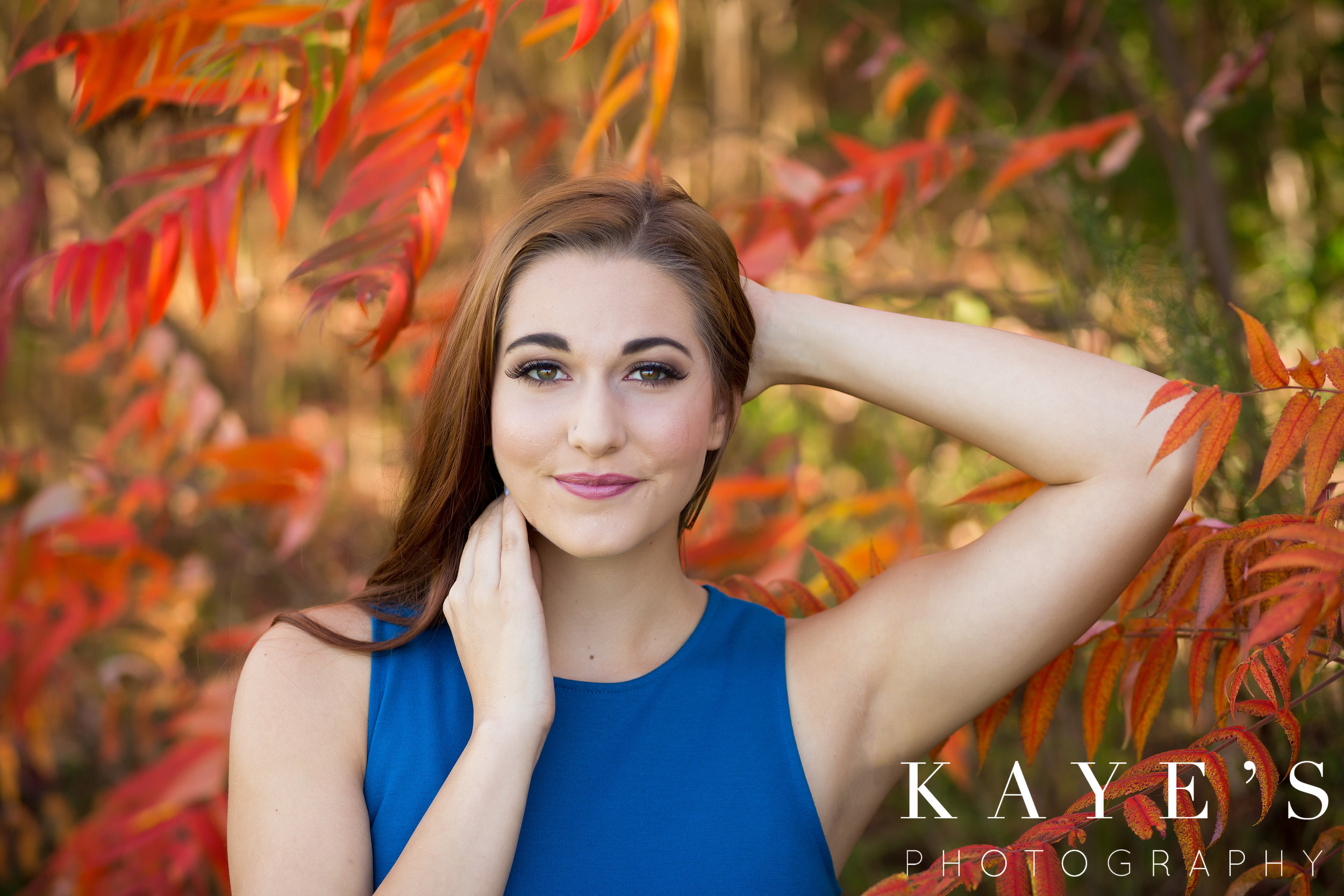 girl posing for senior portraits in grand blanc michigan for kaye's photography