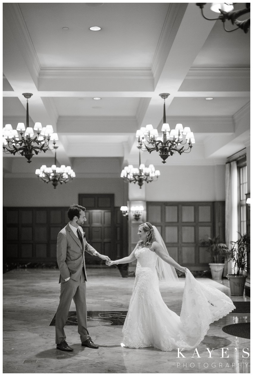 bride and groom dancing in the entry way of royal park hotel on wedding day
