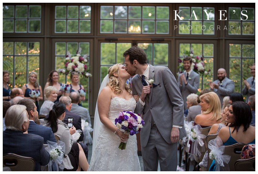 Bride and groom kissing after ceremony on wedding day at royal park hotel
