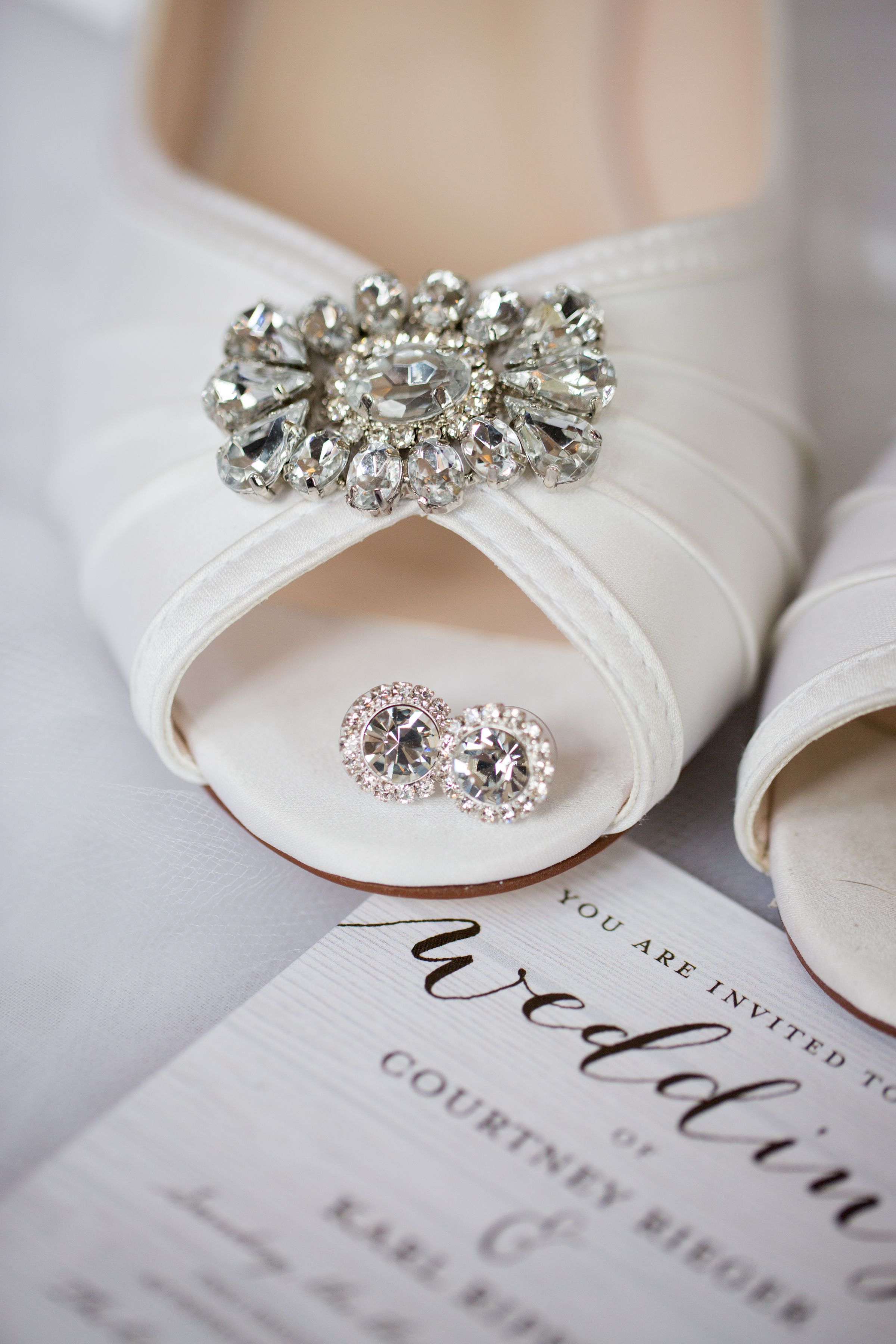 detail image of wedding day earrings with shoes by detroit wedding photographer