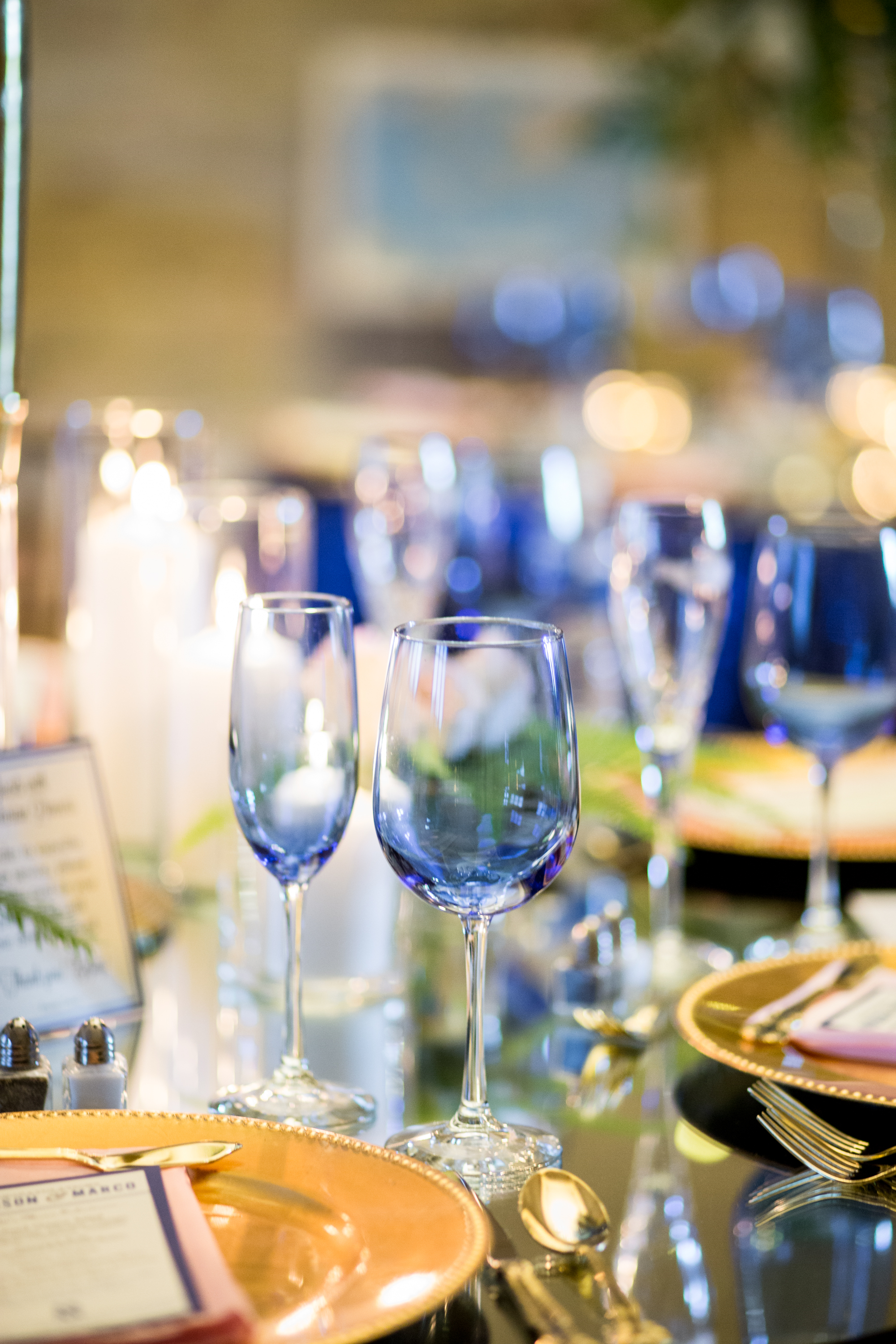blue colored glasses to add depth to wedding tablescape