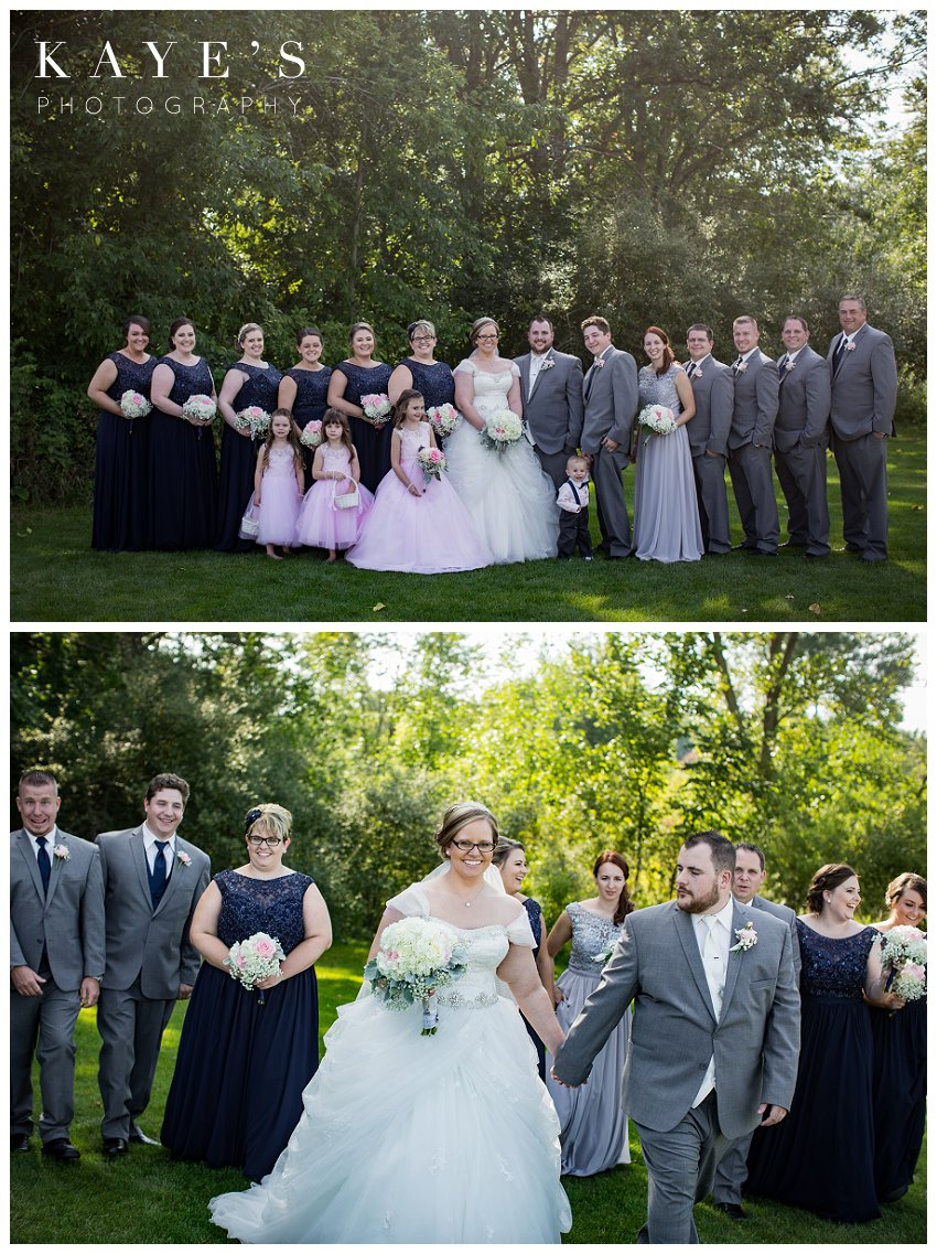 bride and groom with bridal party during wedding pictures in detroit
