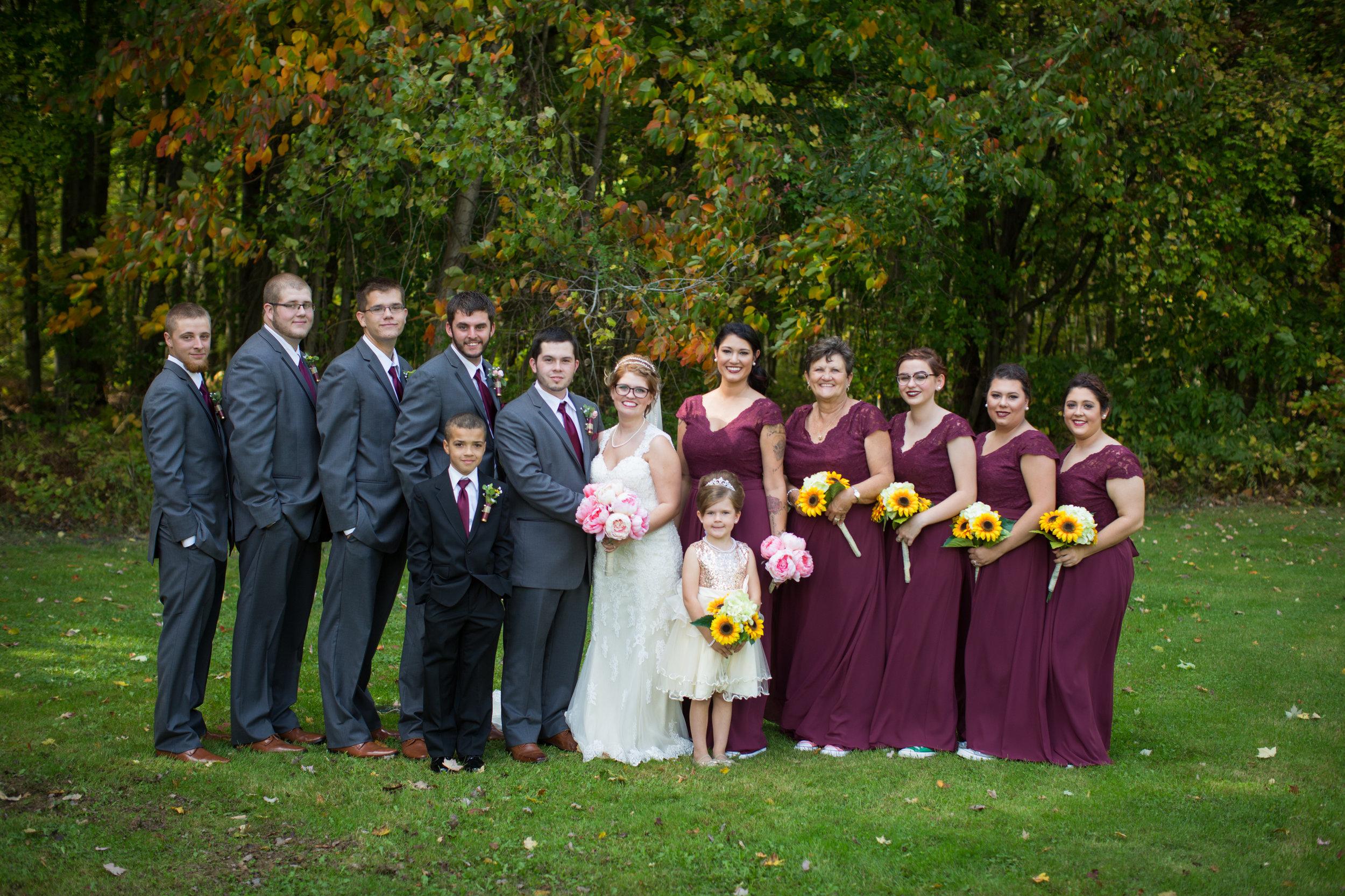 bridal party posing for Michigan wedding photographer during wedding photos