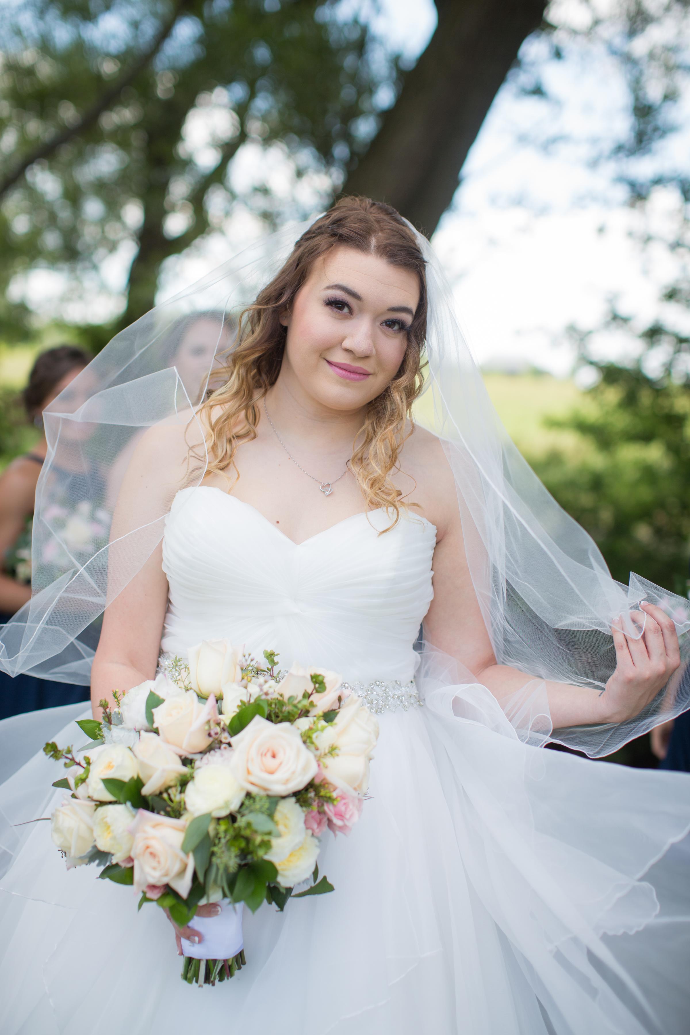 Bride posing for wedding photos with a Detroit wedding photographer
