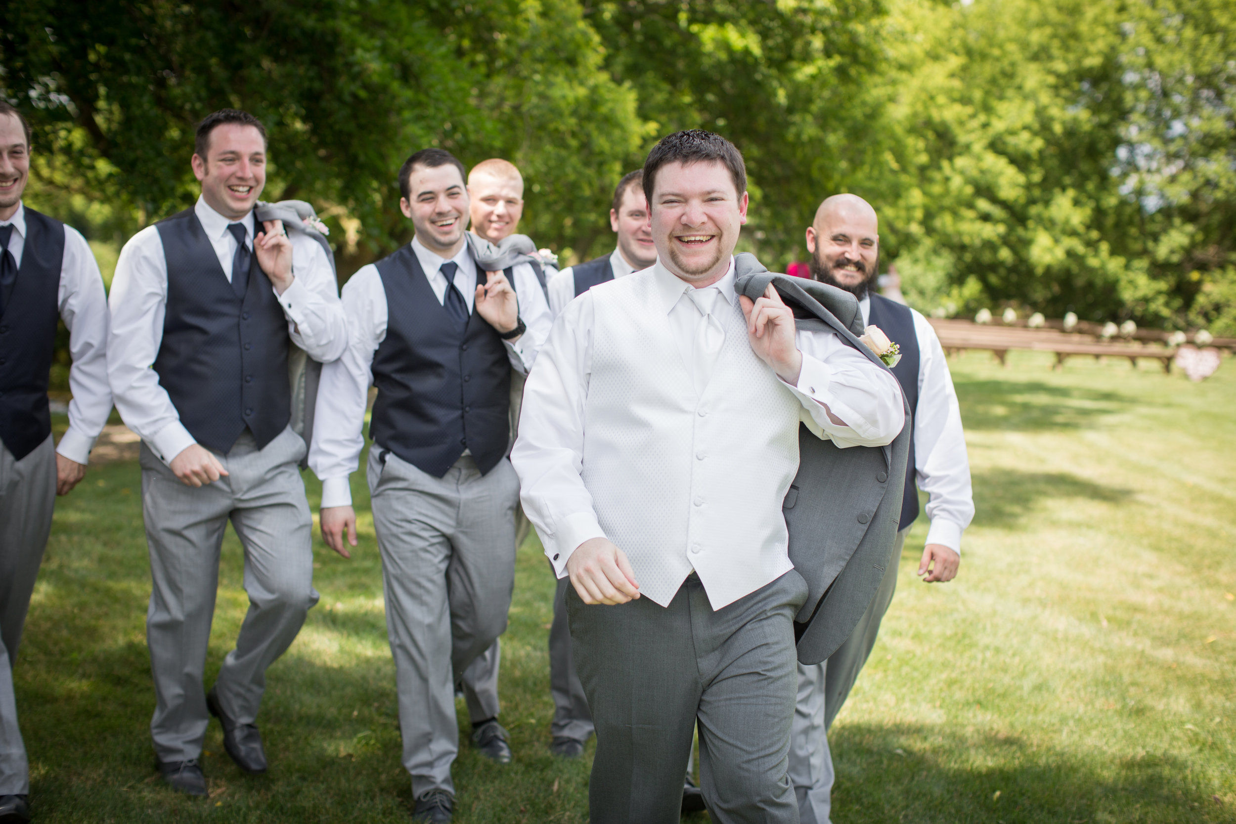 Groom walking with his guys while taking wedding photos is detroit michigan