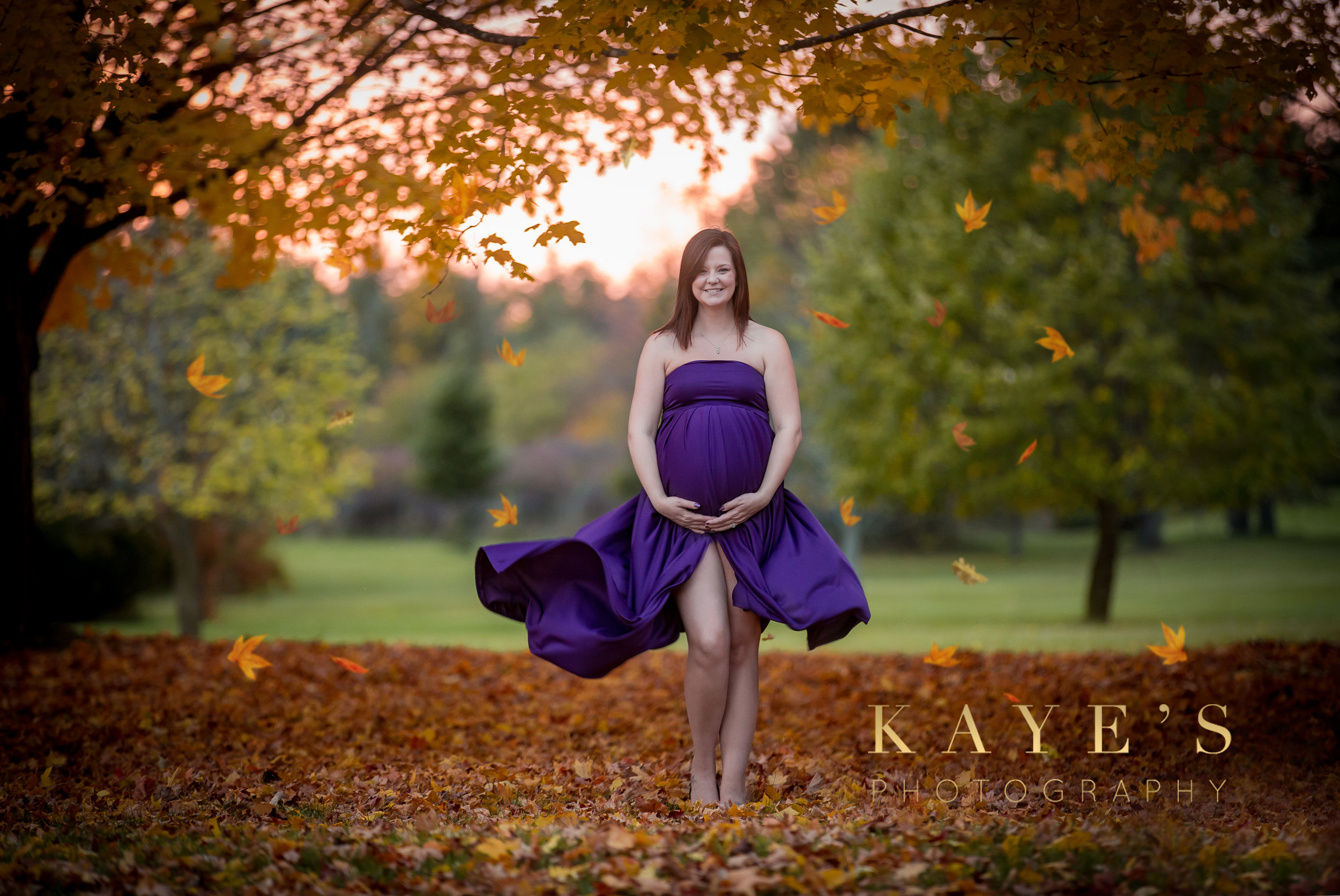 Woman taking professional maternity photos in the fall in grand blanc Michigan
