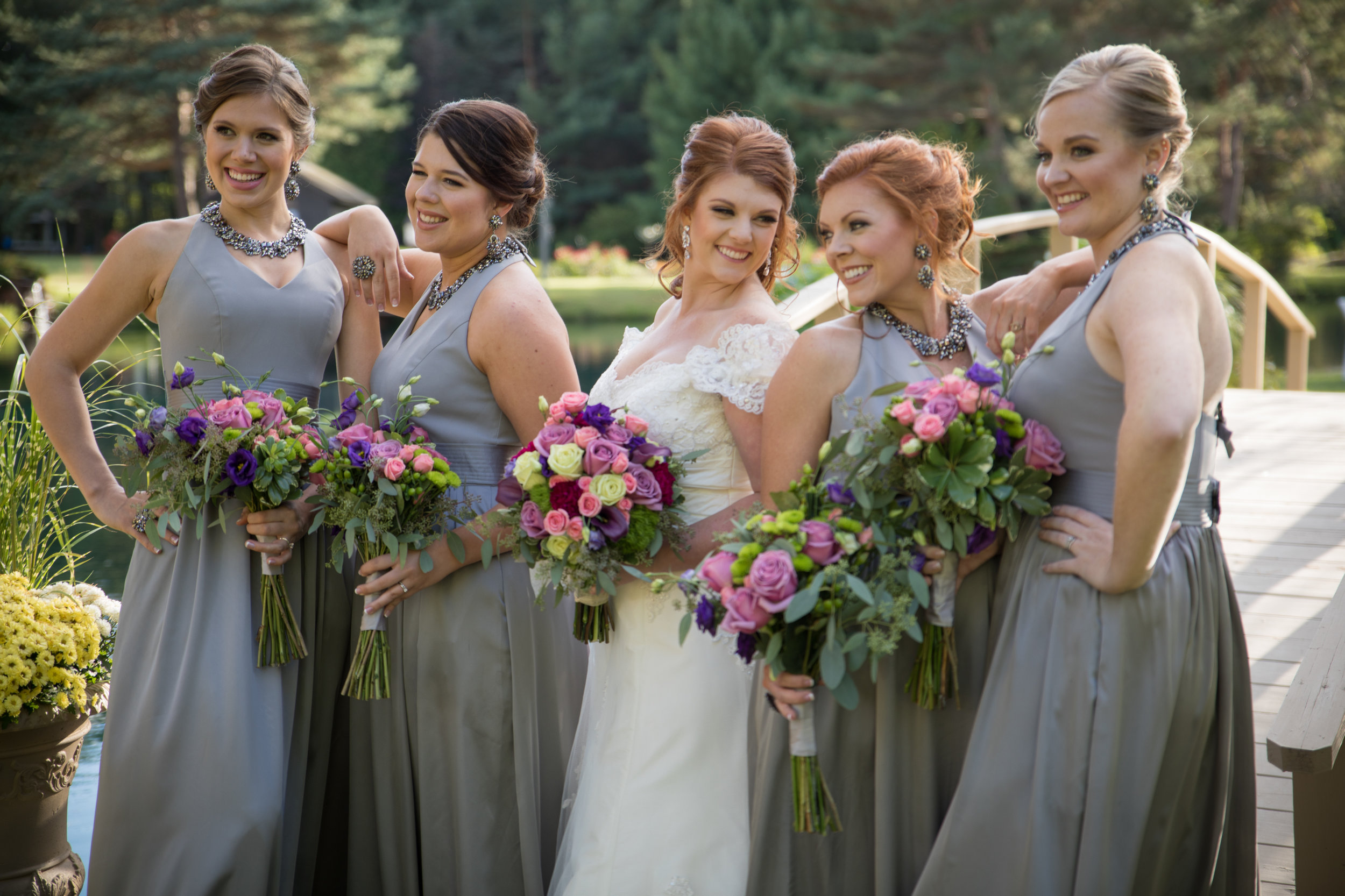 Bride posing with bridesmaids for professional wedding photographer