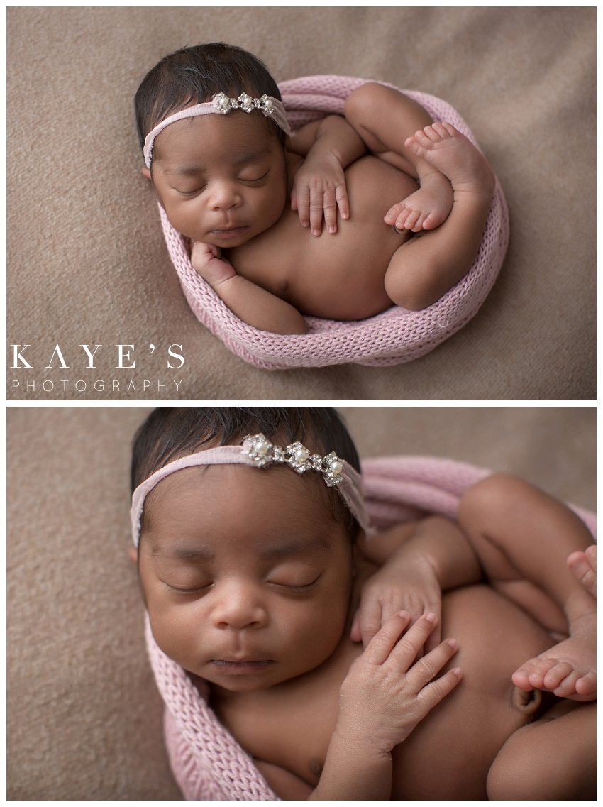baby girl wrapped in pink posing for newborn baby pictures