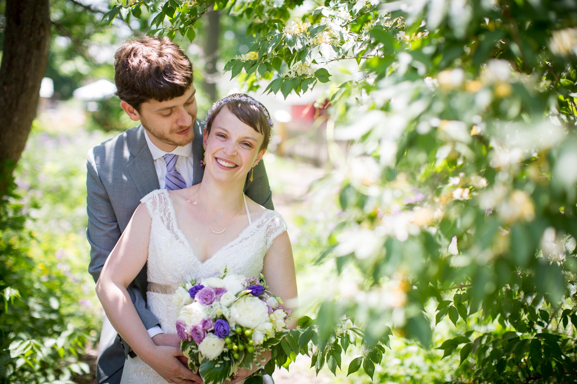 bride and groom posing for wedding photos